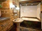 Chestnut bathroom overview towards bath and shower.