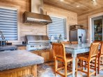 Outdoor Summer Kitchen Featuring Stainless Steel Appliances