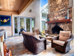 Outdoor Summer Kitchen Featuring Stone Fireplace and Large HD Flat-Screen TV