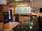 Granite countertops, double oven, grill, large fridge, and incredible view!
