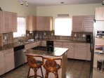 Modern, completely renovated island kitchen with granite counter tops, tumbled marble back-splash and all stainless...