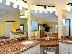 Master bath has his/hers granite topped vanities, makeup station, two-person jetted tub, walk-in shower