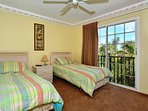 3rd bedroom has two twin size beds with floor-to-ceiling sliders with a view of the pool area