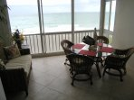 Enclosed, air conditioned lanai has an amazing view of the Gulf and the beach below.
