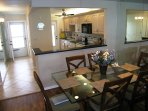 Dining area is right off the kitchen with seating for six