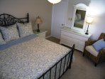 2nd bedroom with king-size bed, large window overlooking the bay and boat docks, HDTV