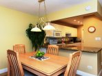 Dining room is right off the kitchen with seating for four