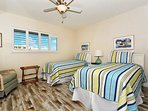2nd bedroom with two twin-size beds, HDTV, large window overlooking the bay and boat docks