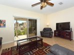 Spacious living room with walkout to lanai and view of Siesta Beach and Gulf - leather furniture, flat screen HDTV