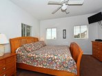 Master bedroom with king-size bed, view to beach, flat panel HDTV, large walk-in closet