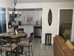 Updated kitchen with all stainless steel appliances, dining table with seating for four