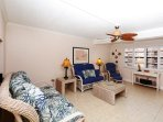 Spacious living room with large HDTV, walk-out to lanai