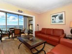 Spacious living room with HDTV, view to Lanai, beach and Gulf of Mexico