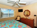 Master bedroom with king-size bed, HDTV, large bay window overlooking beach and Gulf, walk-in closet