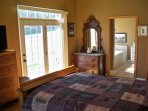 Large bedroom with attached bathroom and french doors leading out to private balcony.