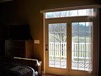 French doors in bedroom going out to balcony.