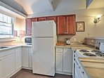 Well-kept appliances and  spacious countertops provide all you'll need to prepare exciting home-cooked meals for your...