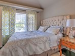 Drift off to a peaceful sleep in this bedroom's queen-sized bed.