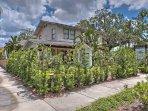 Lush green foliage invites you to this gorgeous home.