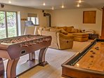 The rec room features a large sectional, foosball table, and shuffleboard for your gaming needs!