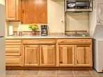 This well-equipped kitchen is complete with fridge, convection oven, and microwave.