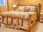 Cozy up in this queen-sized bed with beautiful wooden bed frame.
