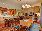 Open kitchen, dining room, living area with ample seating.