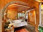 Chestnut Bedroom with internal wooden shutters on windows for a tranquil nights sleep.