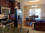 Fully Equipped Kitchen, with Marble Counter-Tops, and Stainless Appliances.