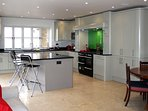 A spacious fully equipped social kitchen with breakfast bar - enjoy the views across to the commons