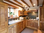 Kitchen with welsh slate worktop. High quality utensils and host of cooking equipment.
