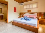 Master bedroom with king size bed, satellite tv and ensuite bathroom.