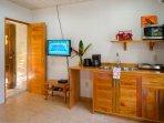 Cabin satellite tv and kitchenette. Door leads to ensuite bathroom.