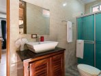 Cabin bathroom with separate entrance to bbq area.