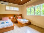 Bedroom 2 with 2 single beds. An extra mattress is available for larger groups.