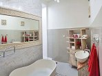Red room with amazing bathroom.