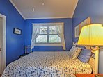 The blue bedroom offers a queen bed and ensuite bathroom for extra privacy!