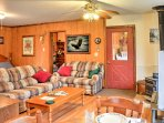 This open living area features 2 couches, a large TV, and beds for extra sleeping accommodations.