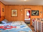 Sleep in queen and full-sized beds against the back wall for a good night's rest!