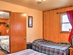 When you're ready for bed, head to the bedroom where you'll find a queen and twin-sized bed.