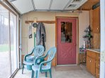 The screened-in porch allows you to enjoy evenings from the comfort of the cabin.