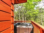 Admire the picturesque mountain views from the private hot tub out on the deck.