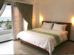 Deluxe room with 1 king size bed good for 2 persons.