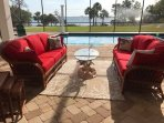 My new rattan couches with red Sunbrella fabric.