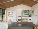 Kitchen with fridge/freezer, washing machine, hot/cold water from natural gas