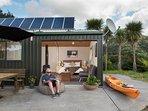 Solar panels, TV aerial, kayak, rusticality
