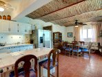 Open kitchen with everything you need to enjoy your vacation. There is a  patio door to the balcony