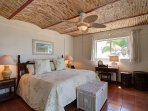 A beautiful master bedroom with full ensuite bathroom and ocean views