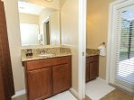Downstairs Master Suite Bathroom, with direct access to pool area.