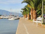 Take a walk at the harbor of Lumbarda and enjoy the view.